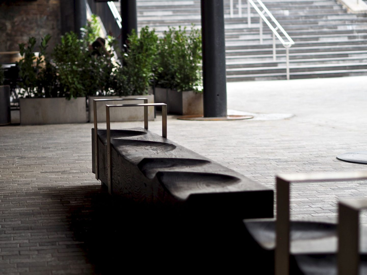 Coal Drops Yard, black wood bench seating, Mary Middleton for Hello Peagreen