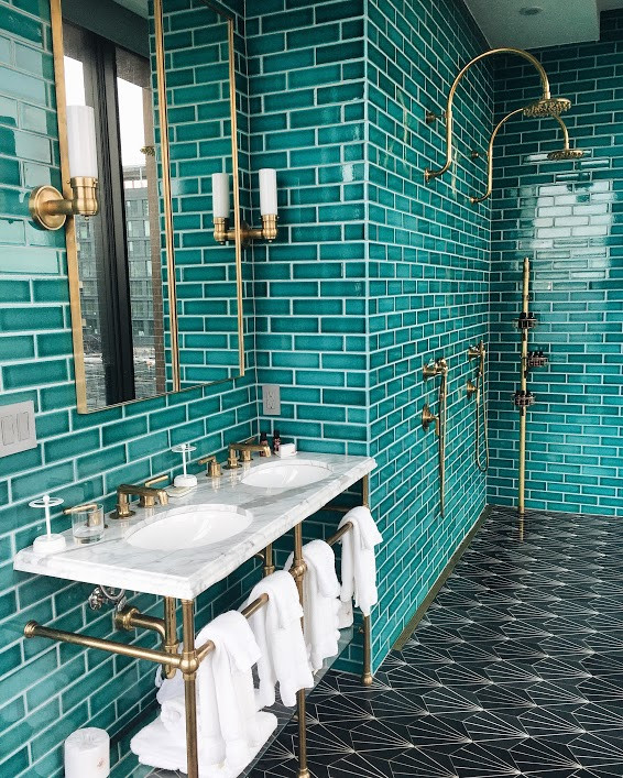 Green bathroom, brass hardware, The Williamsburg Hotel by Michaelis Boyd